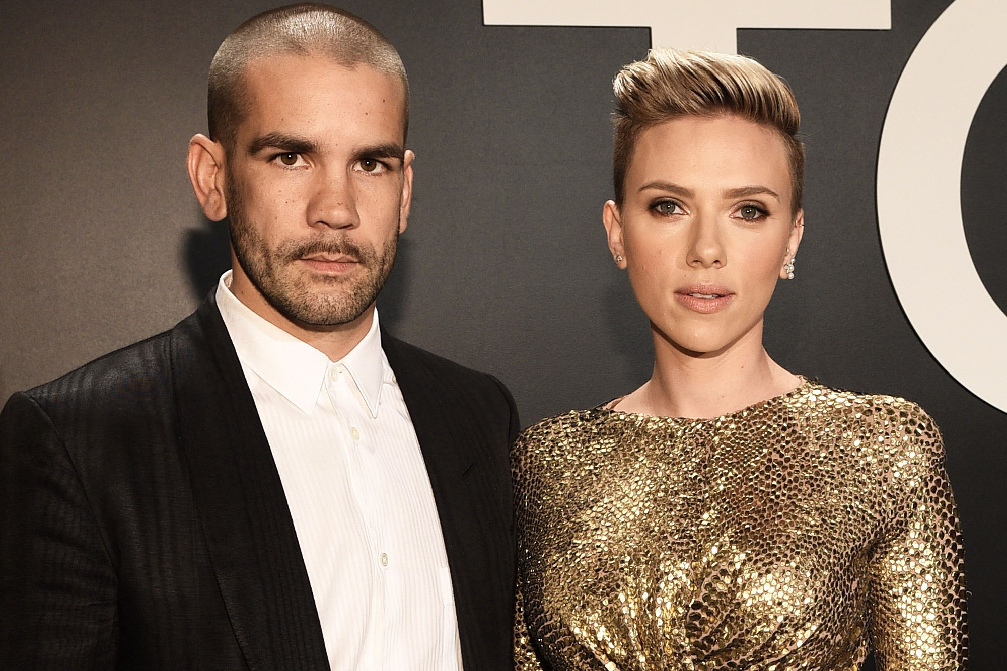 LOS ANGELES, CA - FEBRUARY 20:  Journalist Romain Dauriac (L) and actress Scarlett Johansson, both wearing TOM FORD, attend the TOM FORD Autumn/Winter 2015 Womenswear Collection Presentation at Milk Studios in Los Angeles on February 20, 2015.  (Photo by Michael Buckner/Getty Images for Tom Ford)